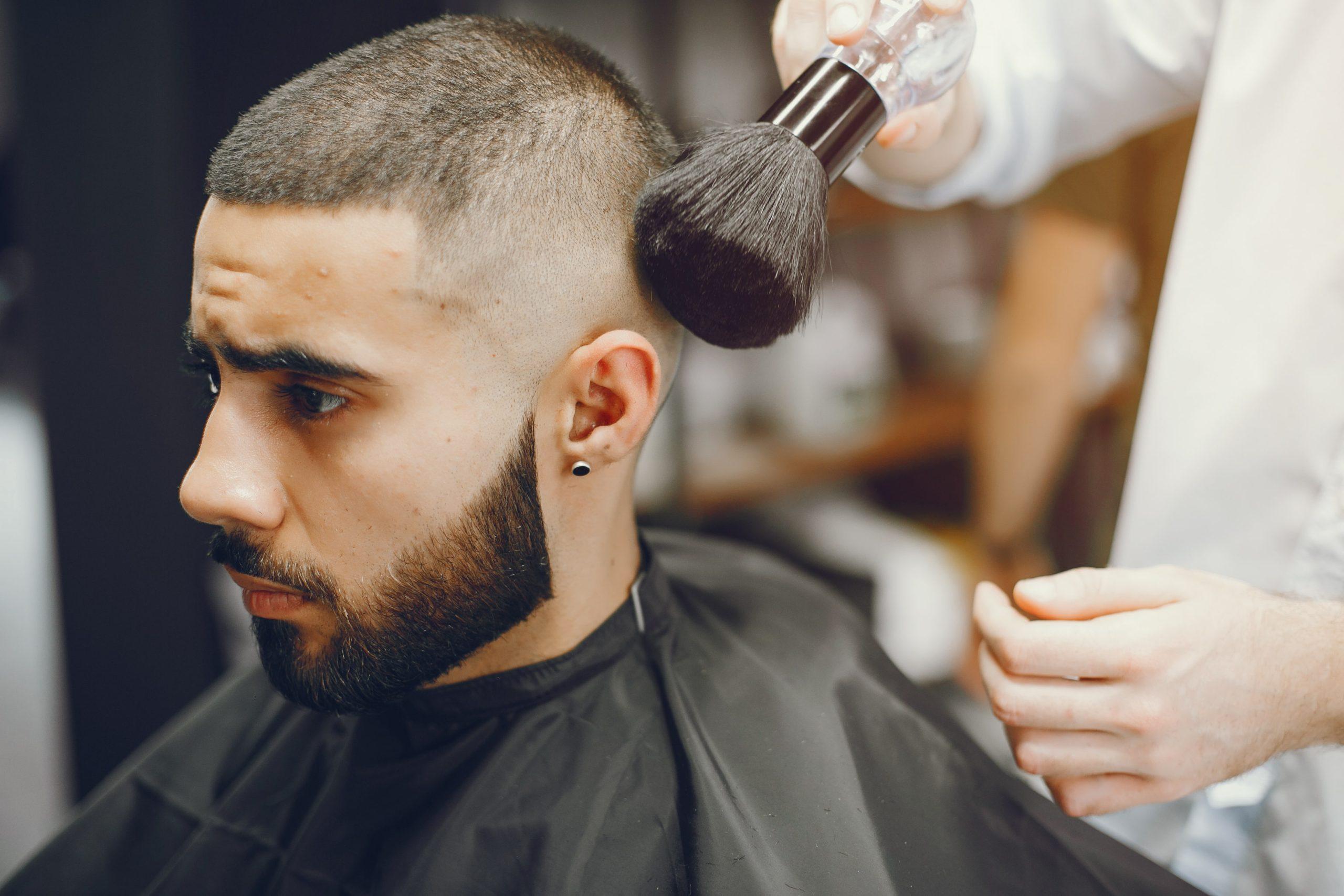 man cuts his beard barbershop min scaled